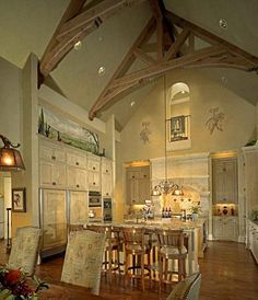 .Kitchen with Hand Carved Limestone Hood - Stained and Glazed Kitchen Cabinets with Hand Scraped Hardwood Floors