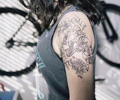 A dinosaur skull tattoo design surrounded by flowers. Sunflower Tattoo Shoulder, Sunflower Tattoo Small, Sunflower Tattoos, Sunflower Tattoo Design, Rose Tattoos, Leg Tattoos, Girl Tattoos, Small Tattoos, Tatoos