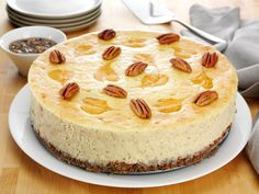 Famous Pumpkin Pecan Swirl Cheesecake recipe from Food Network's chef Alex Guarnaschelli, as seen on Fischer Nuts tv commercial