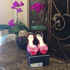 "Anne Klein ""AKELISHA"" Vibrant Pink patent leather sling back heel w/buckle. Open toe w/matching pink & white satin bow accent at toe. Size 10, run small cuz I'm normally a 9.5. Great spring/summer color!Heel height 4-1/4"", platform (minimal) 1/2"". Pictures are best description, but any questions please ask. Fair, respectful & reasonable offers welcome. Please no lowball offers & no negotiations in comments - use the offer feature. Trades ️️ Anne Klein Shoes"
