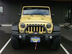 2014 Jeep WranglerUnlimited Rubicon 4x4 Rubicon 4dr SUV SUV 4 Doors Beige for sale in Bremerton, WA Source: http://www.usedcarsgroup.com/used-jeep-for-sale-in-bremerton-wa
