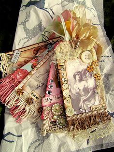 fabric tags - if used on a gift, the recipient would be gifted twice - very nice and very beautiful.  Look fun to make.