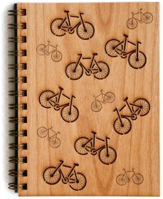 BUDD + FINN Bicycles Wood Journal.  This beautifully handcrafted journal features bicycle design cover that is made of laser-cut certified, sustainable alder wood,  planner, organizer