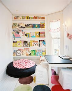 A colorful beanbag chair in front of a built-in bookcase
