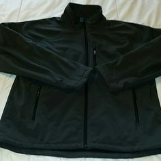 MEN'S fleece-lined jacket. Size XL. Fantastic men's jacket. Fleece-lined and water resistant will keep him warm and dry this winter. Dark gray color. Chest measures 25 inches across laying flat. 29 inches long from the shoulder. Like new condition. Fabric content shown in photo Free Country  Jackets & Coats