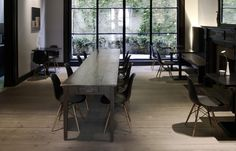 Nice restaurant with black Eames Plastic Side Chairs in the Hotel Julien, Antwerp, Belgium.