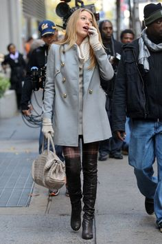 Channel Blake Lively as the temperatures cool by wearing over-the-knee boots with plaid tights and a tailored grey coat.