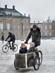 Crown Princess Mary on the bike at Amalienborg Castle after picking the twins, Prince Vincent and Princess Josephine up from daycare on January 11, 2016.