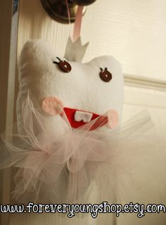 Princess Tooth Fairy Pillow. Love the tutu idea and the little crown up top, but the face seems a bit scary.
