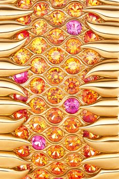 Tiffany & Co. Schlumberger® bracelet in 18k gold with pink sapphires and spessartites. Tiffany Blue Book.