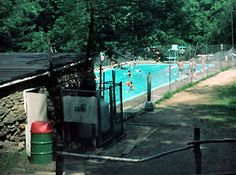 """This is the old Buckeye Swimming Pool at Camp Tuscazoar.  Some scouts got their first taste of being in the water here, while others achieved a real """"milestone"""", the mile swim. A lap across the pool was required to receive the camp's Pipestone Awards, and many first-year scouts with a fear of water would have their whole troop cheering them on to the other side. The pool was also used as a water source for our bucket brigade when we tried to extinguish a fire in the nearby dining hall in…"""