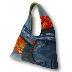 一点もの。古着ジーンズと金襴と手染め藍染めデニムの大きめなリメイクHOBOバッグです。 カジュアルファッションにお勧めです。バッグの内側は、着物地の総裏付...|ハンドメイド、手作り、手仕事品の通販・販売・購入ならCreema。