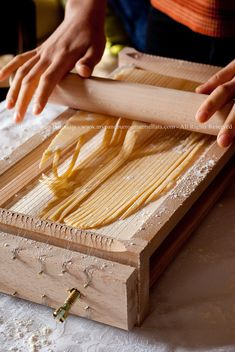 traditional nonelectric pasta maker from Abruzzo, Italia. Pasta Chitarra - guitar pasta