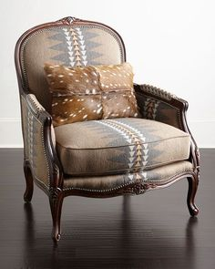 "Handcrafted bergere chair. Hardwood frame. Acrylic/polyester upholstery. Hairhide kidney pillow. 35""W x 36""D x 41""T. Seat, 26""W x 19""D x 20""T; arms, 26""T. Made in the USA of imported materials. Boxed"
