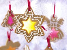 These novelty Christmas cookies shaped like Christmas Trees, Stars, Bells and Reindeer etc.. are fun to make together with children. They particularly enjoy crushing the sweets and using cookie cutters to cut our shapes from the dough. The melted sweets harden to make a window in the centre of the biscuits and these stained glass window cookies are edible decorations as they look wonderful hanging on a Christmas Tree.