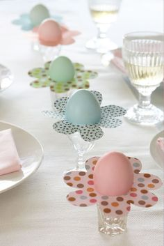 Decorative eggs set on shot glasses as table decor
