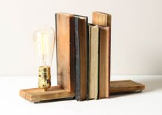 Salvaged wood supports your home library favorites and illuminates their titles.    ITEM DETAILS  ✚ Includes 2 pieces, with a lamp on one end  ✚