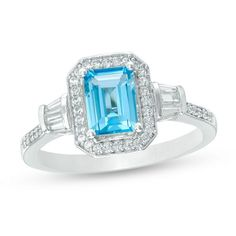 White Gold Emerald-Cut Blue Topaz and CT. Diamond Frame Ring She'll admire the timeless design of this marvelous gemstone and diamond ring. Crafted in cool white gold, this sophisticated look features a x emerald-cut sky-blue t Blue Topaz Stone, Emerald Stone, Blue Topaz Ring, Diamond Stone, Diamond Cuts, Emerald Cut, Ring Displays, Fashion Rings, Ring Designs