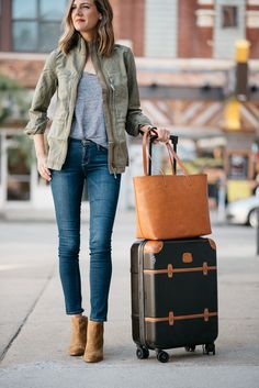 See Anna Jane   See Anna Jane   easy, style, traveling, suitcase, tan bag, bomber jacket, jeans, hardshell suitcase, brown boots, olive green jacket, grey t-shirt, brown tote bag High Level, Cute Suitcases, Angeles, Travel Outfit Summer, Travel Outfits, Fall Outfits, Nyc, Travel Clothes Women, Airport Style