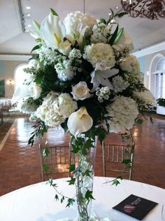 Floral designs by janet king Wedding reception centerpieces