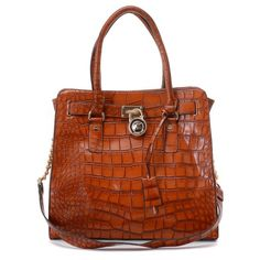 "Michael Kors Gia Embossed Satchel Bordeaux Crocodile-embossed * Bordeaux crocodile-embossed leather. * Gloden color hardware. * Top handles with square buckle detail. * Rounded framed top softens body. * Metal logo plate at top center. * Buckled flaps at sides. * 9 1/2""H x 12 1/2""W x 6 1/4""D."