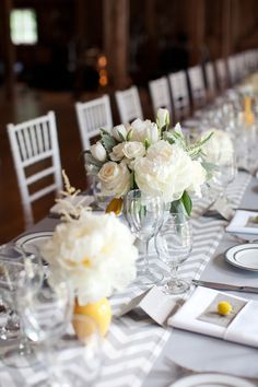 Grey chevron table runner. I love the place settings and the white and yellow vases.