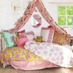 Ok...an outdoor, hanging bed draped with bohemia would be more my style!  Oh, if only my hubby would let me!