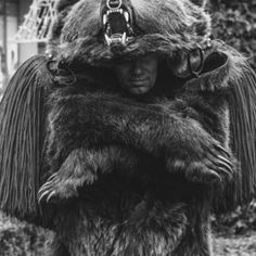 Man dressed in bear suit