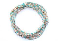 Kralenarmband met roze en turquoise kraaltjes en gevlochten touw van Chapter 42 :: Le Goût des Couleurs producten - Webshop