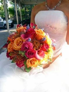 Orange, Pink and/or Yellow OR Sunset Theme Centerpieces :  wedding beach centerpiece feathers orange pink reception sunset yellow Sun3