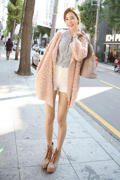 Very cute look! This shot was taken in Japan (sign behind her is in Japanese) but you'd find this look popular in many Asian cities. The soft peach color sweater is a great casual piece. The total look is perfect for doing casual errands around town. -Lily  #jfashion #asianstyle