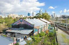 In Perth, Australia, an organic community farm sprang up along a busy railway line.