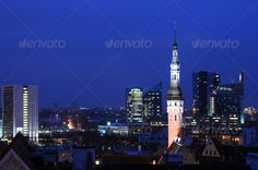 Tallinn at Night a ...  Spire, aerial, architecture, attraction, baltic, blue hour, building, center, centre, city, city hall, cityscape, destinations, downtown, dusk, estonia, europe, evening, exterior, house, illuminated, landmark, lighted, medieval, middle ages, modern, night, nobody, old, old city, old town, outdoors, outside, panorama, roof, sky, skyline, tallinn, tile, tiled, town, town hall, townscape, travel, twilight, view