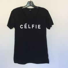 CELFIE black v neck tee Black v neck 100% cotton relaxed fit , size up for an oversized fit, last photo highlighted Tops Tees - Short Sleeve