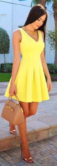 #street #style #womens #fashion #spring #outfitideas | Yellow skater dress.