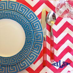Love the Jonathan Adler turquoise Greek key plate and the hot pink monogrammed chevron placemat