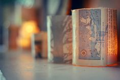 Map Votives: There's nothing more comforting to a weary traveler than the warm glow of a flickering candle. These map covered votives are similarly soothing. (via Arrow & Apple)