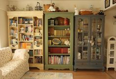 mismatched bookcases: i might go nuts if i had that much random stuff that needed this kind of storage, but me like eclectic.