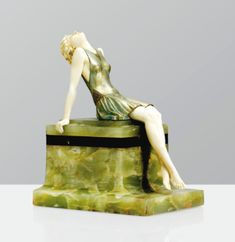 Ferdinand Preiss 1882 - 1943 SUN WORSHIPPER, VERS 1925 SUN WORSHIPPER, A COLD PAINTED BRONZE AND IVORY FIGURE ON GREEN ONYX AND BLACK MARBLE BASE BY FERDINAND PREISS, CIRCA 1925