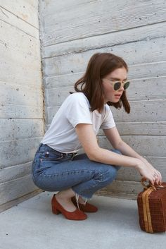 White tee, denim, block heels and a great pair of sunglasses.