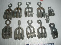 "11 VINTAGE SMALL PULLEYS 1""- 2"""