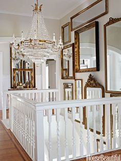 "In the stair hall of Annie Brahler's Jacksonville, Illinois, house, daylight bounces off a Dutch chandelier and assorted mirrors. ""It's great — you double the size of the space,"" she says."