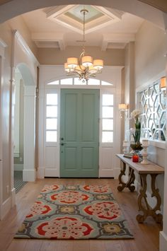 Paint the inside of the door a fun color with a matching printed rug. Corinne Madias Sells homes in West Bloomfield,Michigan Joe Carrick Design http://stripedpeony.com/portfolio-item/the-bradshaw-home/