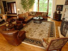 This ivory black 10x14 hand knotted 100% wool oriental area rug pairs perfectly with the leather furniture and subtitle black accents through out the room. The designers at Area Rug Dimensions sized this rug perfectly for the furniture placement in the room.