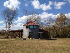 Outside of 2 grain bins turned into a house.