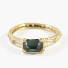 Like the femme fatale for which it is named, the Marlene ring exudes a powerful aura of glamour. This gorgeous piece, with its central deep green sapphire, matches the color of our envy for the lucky woman who gets to wear it. The 1.4 carat baguette-cut sapphire is framed by four large tapered baguette white diamonds and two tiny, sparkling Miner's cut white diamonds, for a total of 0.5 diamond carats. True to the designer's unique method, the stones are cast along with the ...