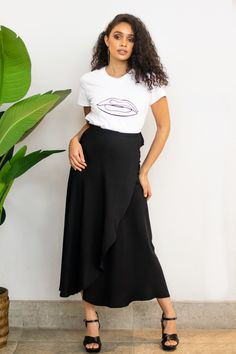 """DRESS TO IMPRESS with our Trendy wrap skirt.  This flowy and chic wrap skirt can be dressed up or down. Pair it with our """"Lips don't Lie' T-shirt and a flatform Sandle for a comfy stylish look or dress it up with our """"Cute but Psycho"""" Body suit and your favorite Wedge/Heels to SLAY the night!   Product Description:  Free size Hidden buttons for size adjustment Waist tie Rayon Fabric - natural synthetic blend Don T Lie, Slay, Wedge Heels, Dress To Impress, Midi Skirt, High Waisted Skirt, Dress Up, Lips, Product Description"""