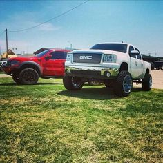white lifted GMC Sierra truck with oversize tires