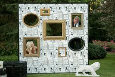 "I thought this was a cute take on the ""photo booth"" idea.  It looks like a board with cut-out frames.  Fun for a wedding or a family reunion."