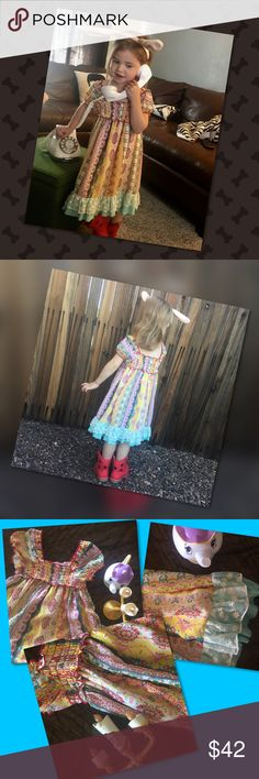 """Sweetly Dressed Party, casual, dressy it's perfect! The model is a size 4, 3' 31/2"""" tall & this size 6 is a little large on her but we wanted you to see how sweet this dress is on. The elastic bodice and cap sleeves with a square cut neckline of 100% soft polyester. Sleeves may be off the shoulder as well. The soft colors with a lace trim and layered hemline, shoulder to hem 24 1/2"""" length. Ella and Lulu Dresses"""